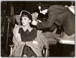 Between scenes from MGM's Madelon, Maureen has her hair fixed by her hairdresser.