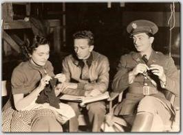 Maureen and Robert Young rehearse their dialogue for MGM's West Point of the Air.