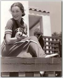 Soaking up the sun at her Malibu beach home, Maureen O'Sullivan and her puppy.