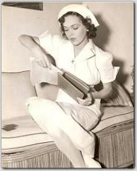 During a break between scenes, Maureen makes an addition to her script for MGM's Between Two Women.