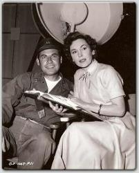 John Hodiak and Miss O'Sullivan rehearse their lines between scenes in Columbia's Mission Over Korea.