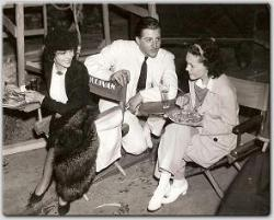 Benita Hume, John Buckler, and Maureen have lunch on the set of MGM's Tarzan Escapes.